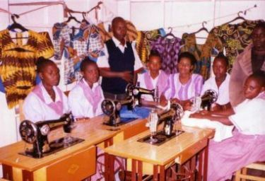 John Simon with Sewing Academy Students