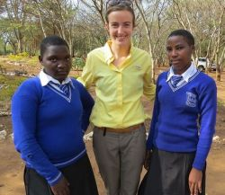 Cassi with sponsored students Albina Alphonce and Jewels Philbert
